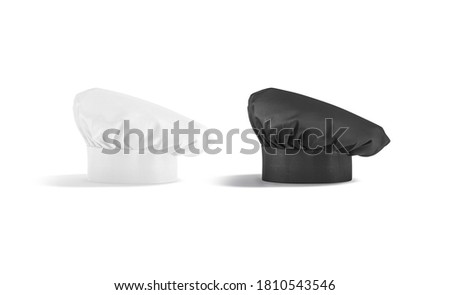 Blank black and white toque chef hat mockup set stand, isolated, 3d rendering. Empty chief-cooker dome headdress mock up, side view. Clear professional blanche costume template. Stock photo ©
