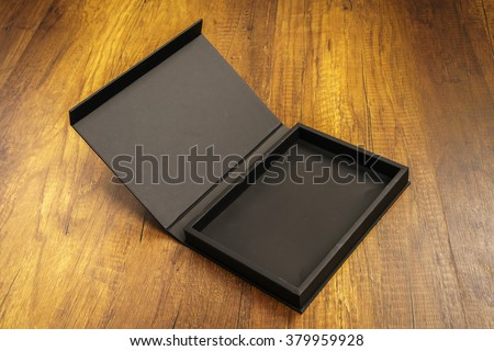 Blank black box mock up on wood background