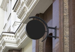 Blank black outdoor round box mockup on marble wall. Empty courthouse or restaurant cityboard on edifice mock up. Clear wal mounted circle screen for cafe logotype mokcup template.