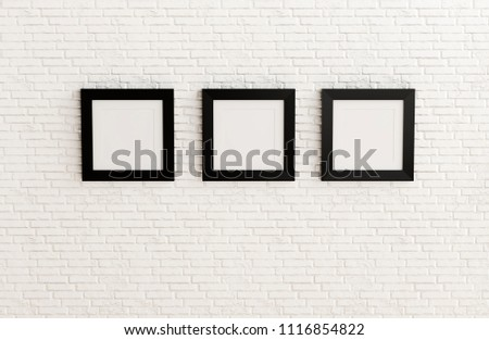 Blank black picture frame template for place image or text inside on white brick wall.