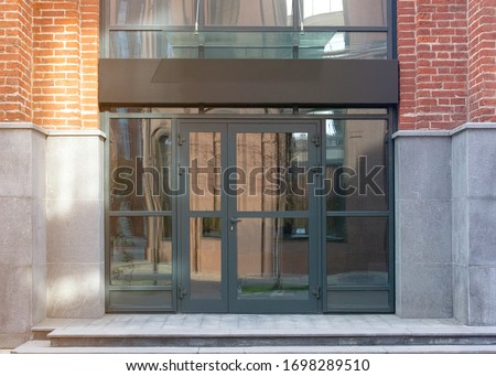 Blank black rectangular box store entrance mockup, glass brick wall, front view. Empty company or restaurant banner with windows and door mock up. Clear boxed frame for boutique mokcup template. Stock photo ©