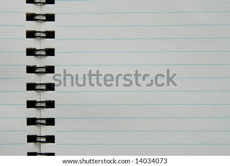 Blank black spiral notebook with textured paper