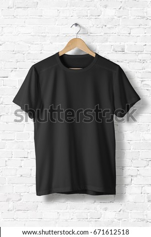 Shutterstock Blank Black T-Shirt Mock-up hanging on white wall, front side view . Ready to replace your design