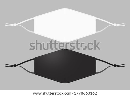 Blank black & white cotton reusable cloth mask isolated on grey background. Flat view. Empty surgical mask for mockup. Clear protective fabric face covering for template & branding. Studio Photography