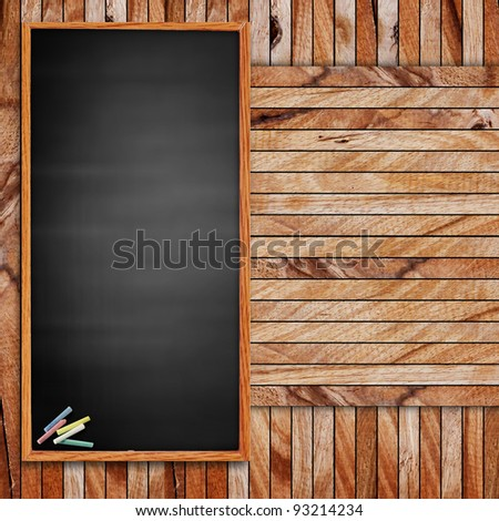 blank blackboard and chalk. on wood with copy-space for writing