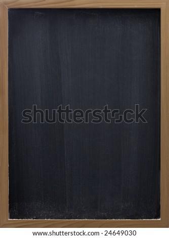 blank blackboard in wooden frame, white chalk eraser smudges