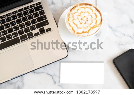 Blank blank business card laptop and cup of coffee on the desk.