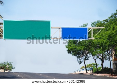 blank blue and green road signs - stock photo