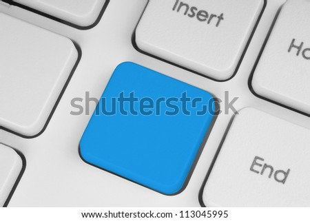 Blank blue button on the keyboard close-up