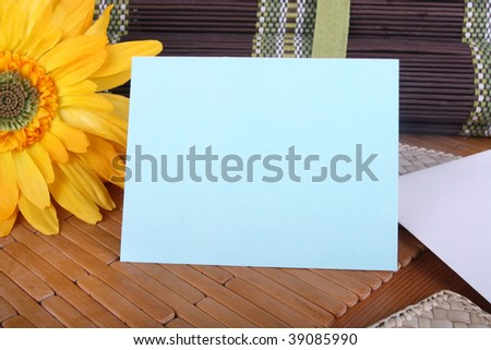 Blank blue card, copyspace, on a table