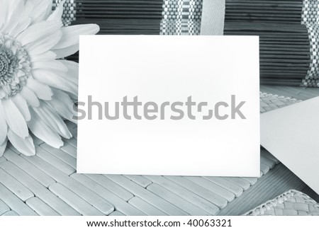 Blank blue card, copyspace, on a table, blue monotone