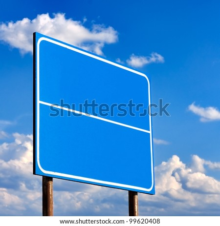 Blank Blue Road Sign Against Light Cloudscape, Summer Sky And Clouds