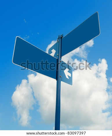 Blank blue road signs in bright sky, clipping path.