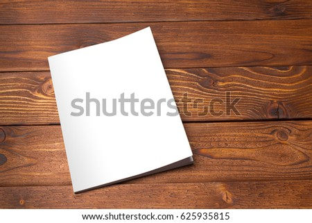 Blank book or magazine cover on wood background #625935815