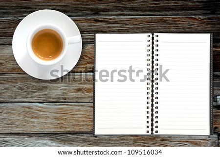 Blank book with coffee frame on wooden background