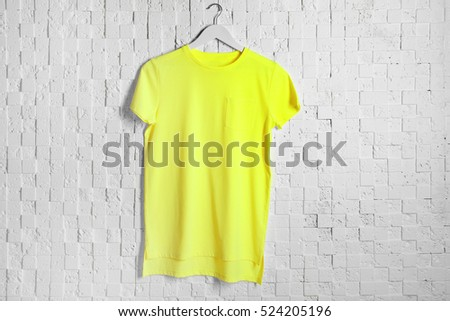 Blank bright t-shirt against light textured background #524205196