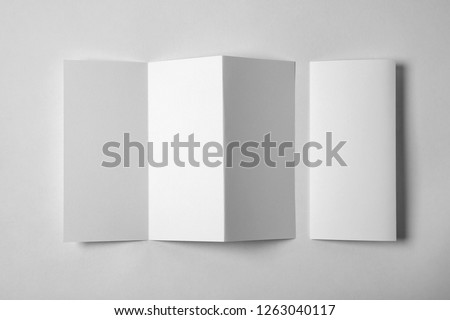 Blank brochure on white background, above view. Mock up for design #1263040117