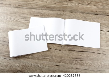Blank brochure on wooden background #430289386