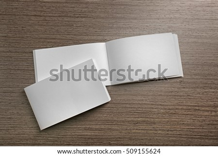 Blank brochures on wooden background #509155624