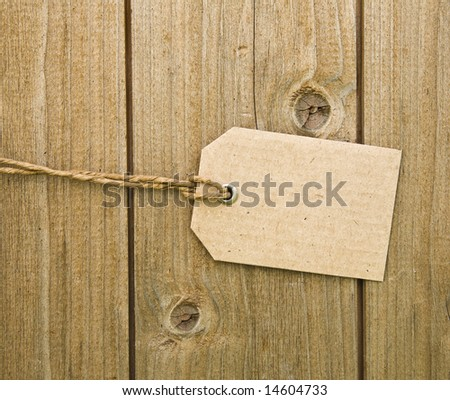 Blank Brown Cardboard Tag On Wooden Background