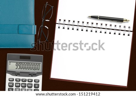 blank brown notebook with stationery on the desk for your text