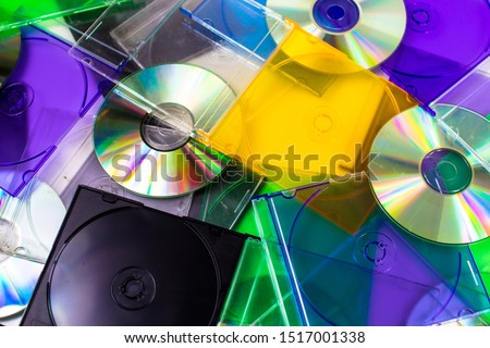 Blank Burnable, Recordable, Writeable & Rewriteable CDs & DVDs with Opened and Closed Multi-color and Black Slim Jewel Cases  Сток-фото ©