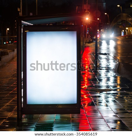Blank bus stop advertising billboard in the city at night. #354085619