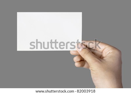 blank business card in a hand isolated on grey
