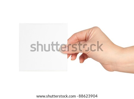 Blank business card in a hand isolated on white - stock photo