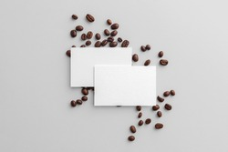 Blank business card mockups with coffee seeds on white background,  coffee packaging mockup with empty space to display your branding design.