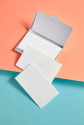 Blank business card on colorful background