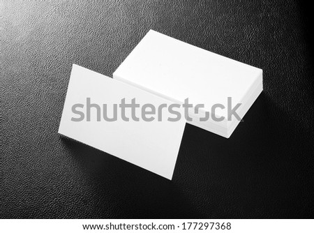 blank business cards on a black leather background #177297368