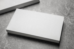 Blank business cards on grey background