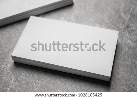 Blank business cards on grey background #1028105425