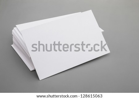 blank business cards stack up on grey background, good for text & logo
