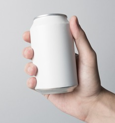 Blank Can in hand on white background, ready to replace your design.