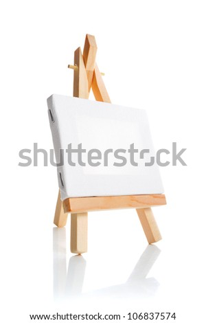 Blank canvas on easel isolate on white background