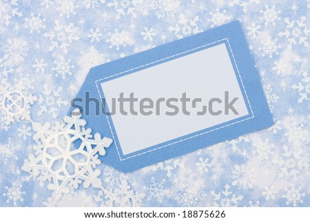 Blank card on blue snowflake background, happy holidays