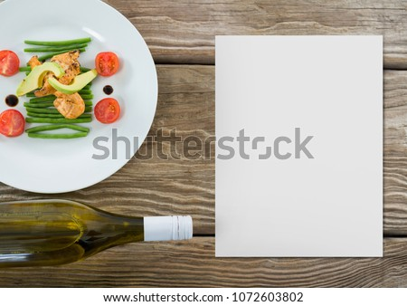 Blank card on wooden desk with food #1072603802