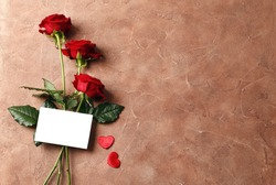 Blank card, red roses on background, top view with space for text. Valentine's day celebration