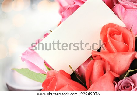 Blank card with a dozen roses. Shallow depth of field with copy space.