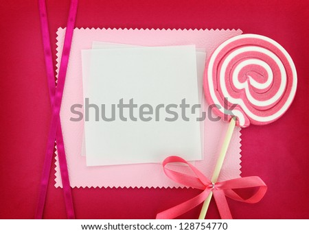 Blank card with lollipop on pink background