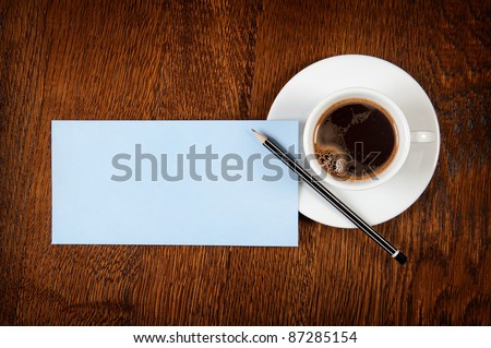 Blank card with pencil on coffee cup with space for your data - stock photo