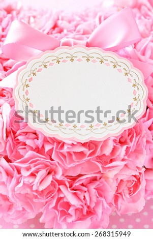 Blank card with pink bow ,beautiful pink carnations background