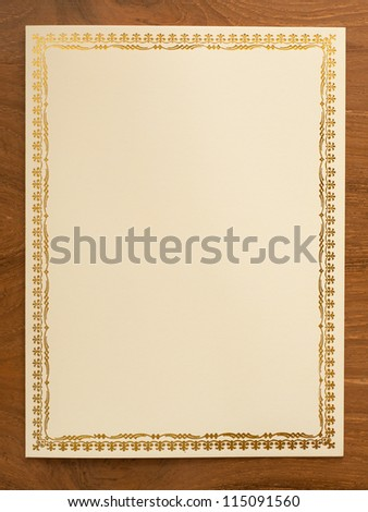 blank card with thai traditional frame on wooden desk