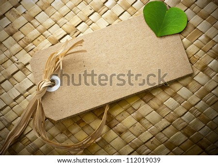 blank cardboard label with a clover leaf onto it, the is room for text, natural background