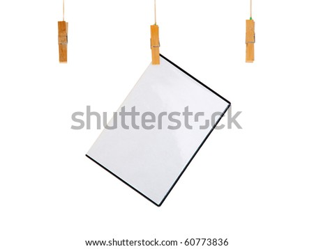 blank CD / DVD cover box with film or game sheet on a clothes line. Isolated on white background. - stock photo