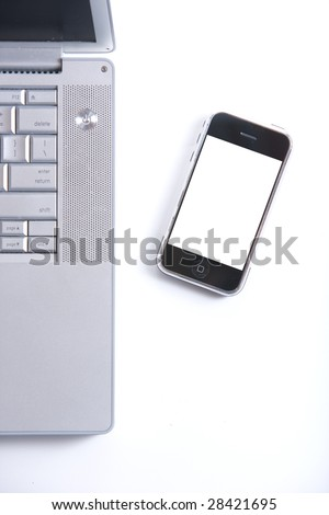 Blank cell phone on a keyboard for your text or image