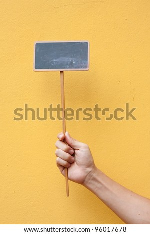 Blank chalkboard for text on yellow background