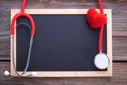 Blank chalkboard, stethoscope and red heart, health background concepts.